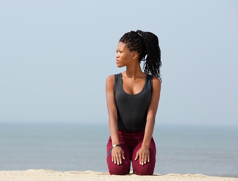 black-woman-meditate-beach-natural-hair